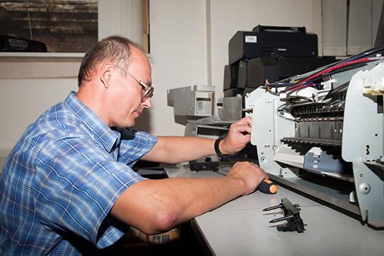 Ремонт принтера, пострадавшего от неоригинальных картриджей, в сервисном центре