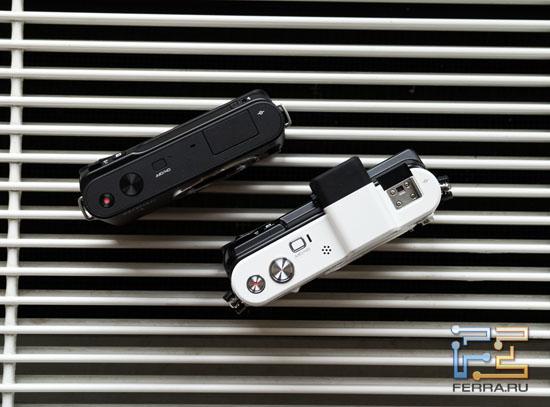 Верхние стороны камер Nikon 1 V1 и J1